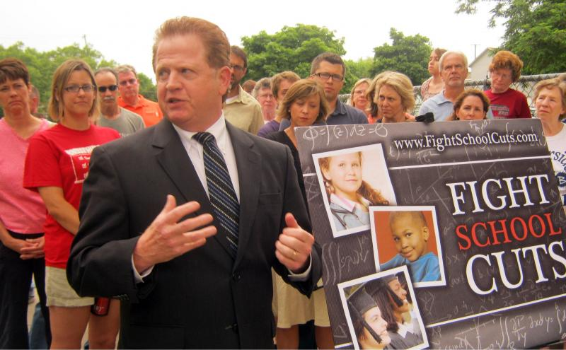 Rep. Schmidt at a rally against Governor Rick Snyder's budget cuts to education funding in June of 2011. He's now switched to the GOP.