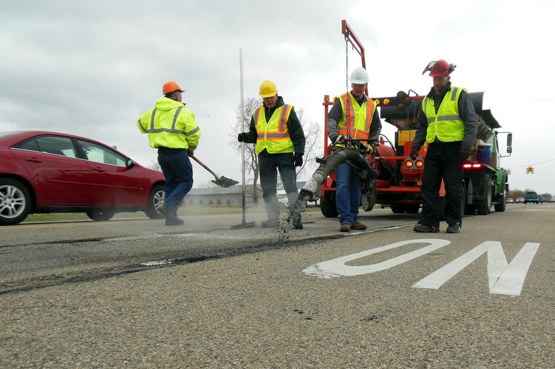 Governor Snyder patches potholes on M-37 in Kent County Thursday afternoon.