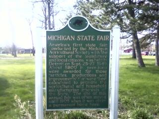 A sign designating the Michigan state fairgrounds as a historic site.