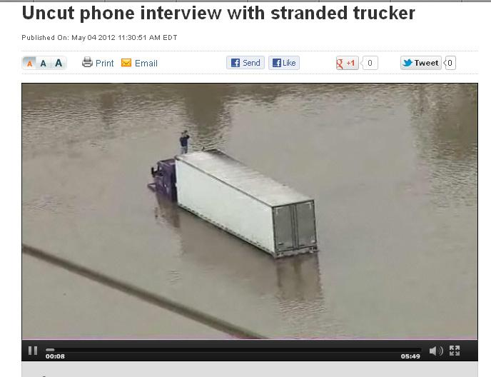 WDIV interviewed a trucker stranded by the flooding near Flint.