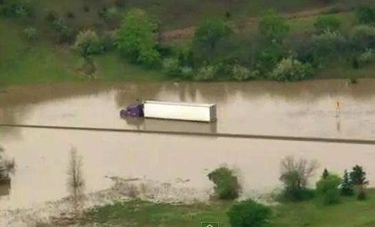 A stranded trucked on southbound I-75 near Flint. He was recued by a boat from the roof of his cab.
