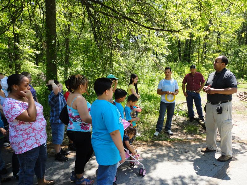 Belle Isle Nature Zoo Manager Mike Reed shows off a new nature trail DPS students helped clear.