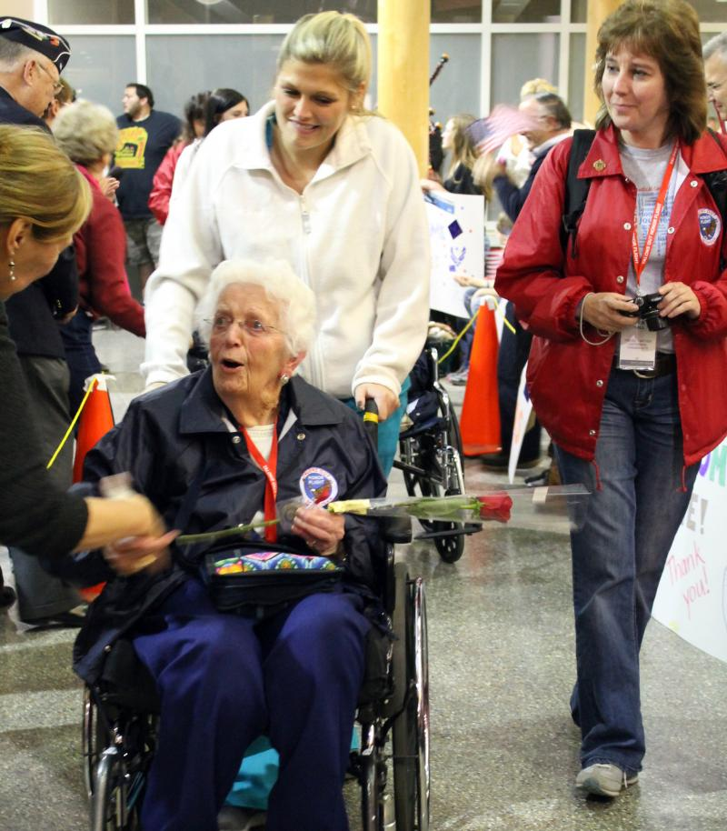 Crowds in Kalamazoo welcome WWII veteran Catherine VandeBunte home after a long day in Washington D.C.