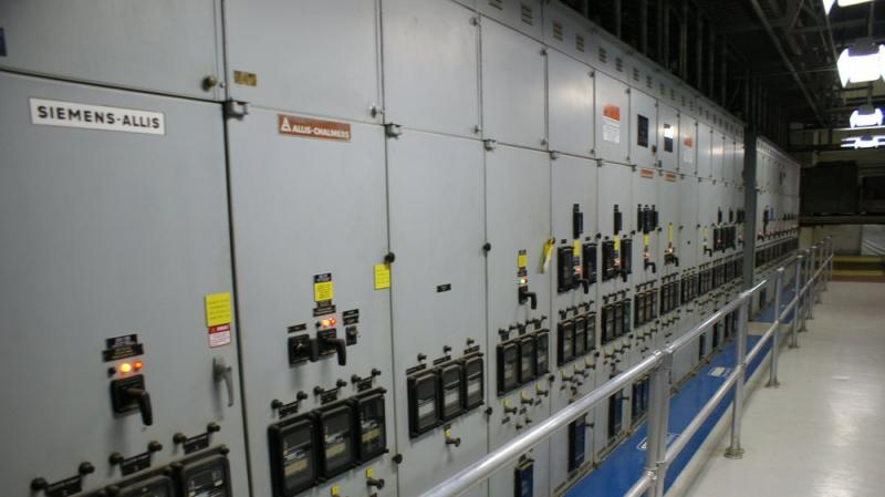 These large electrical panels on the second level direct electricity from the generator to various parts of the plant.