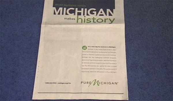An ad in the Wall St. Journal touting Michigan's controversial right to work law along with the Pure Michigan logo.