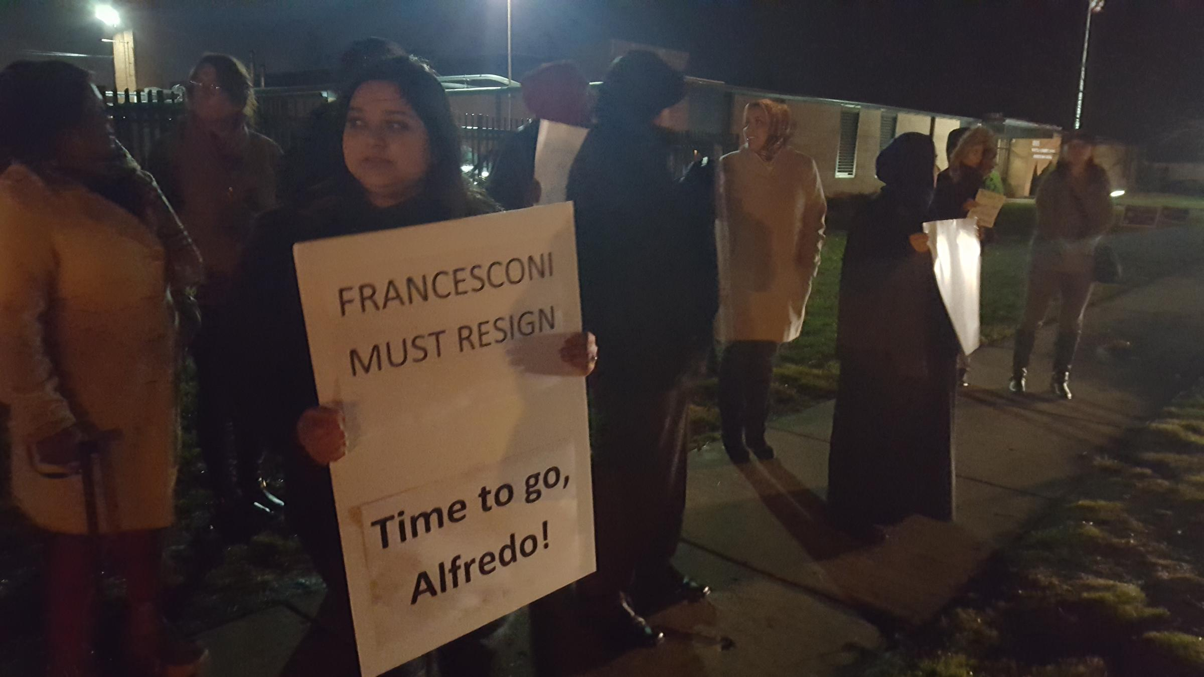 Protestors stand outside Roseville Community Schools building urging the  removal of Vice President Alfredo Francesconi