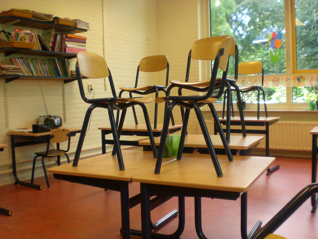 Classroom chairs stacked - Chairs Stacked On A Desk In A Classroom