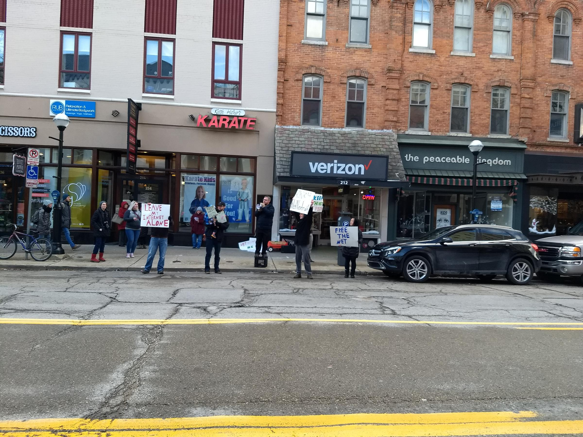 Activists gather at University Verizon to protest net neutrality rollback