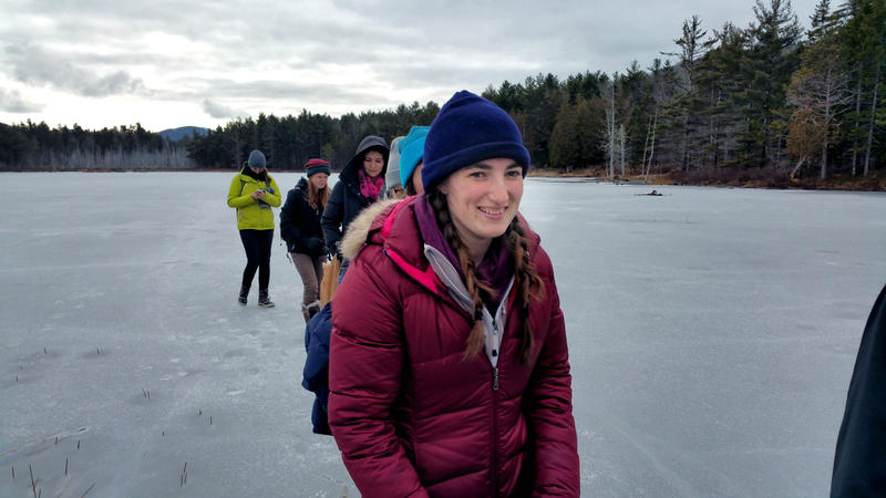 Siobhan Ricker and other students from College of the Atlantic trek across lake ice, searching for otter indications.