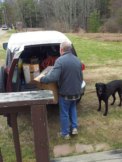 Steve Conary, one of the lucky residents with someplace to go, packs up his truck.
