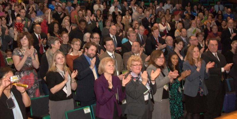 The opening night crowd engaging in applause at the GOP Convention inside the Cross Insurance Center in Bangor on April 25, 2014.