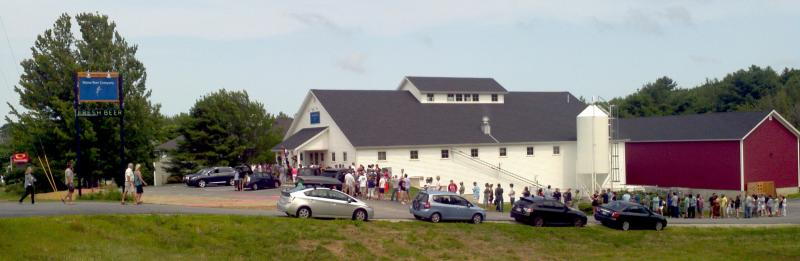 The line extends beyond the frame of the picture at Maine Brewing Company in Freeport.