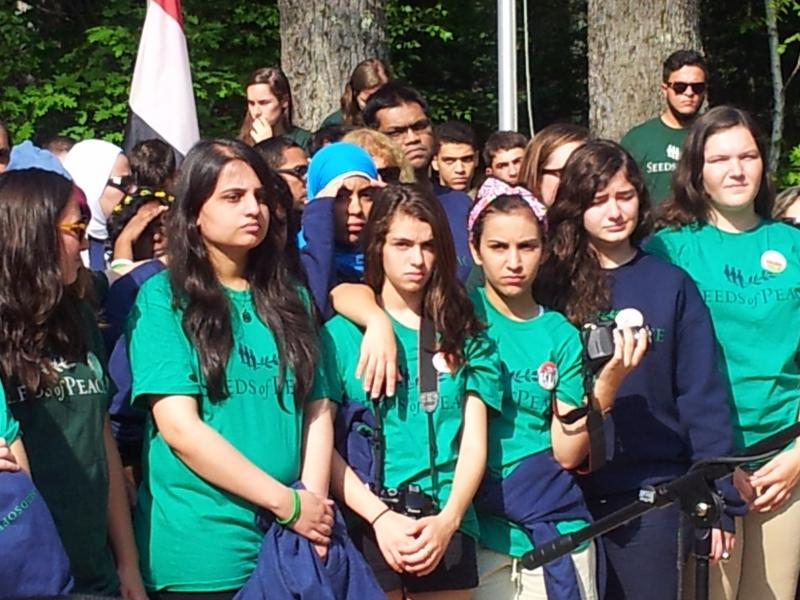 Campers listen to the opening ceremony at Seeds of Peace Camp.