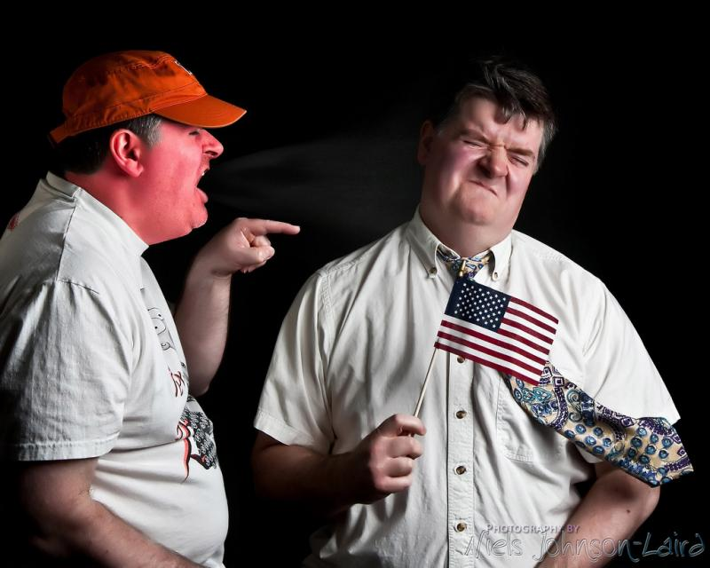 Stock image showing two men arguing about politics, ostensibly.