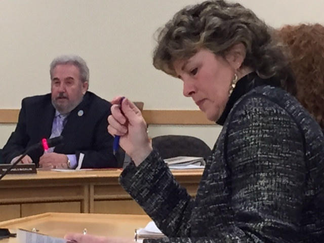 Sen. Stan Gerzofsky presses for a review of the Northern New England Passenger Rail Authority, as Beth Ashcroft, executive director of the Office of Program Evaluation and Government Accountability, takes notes.