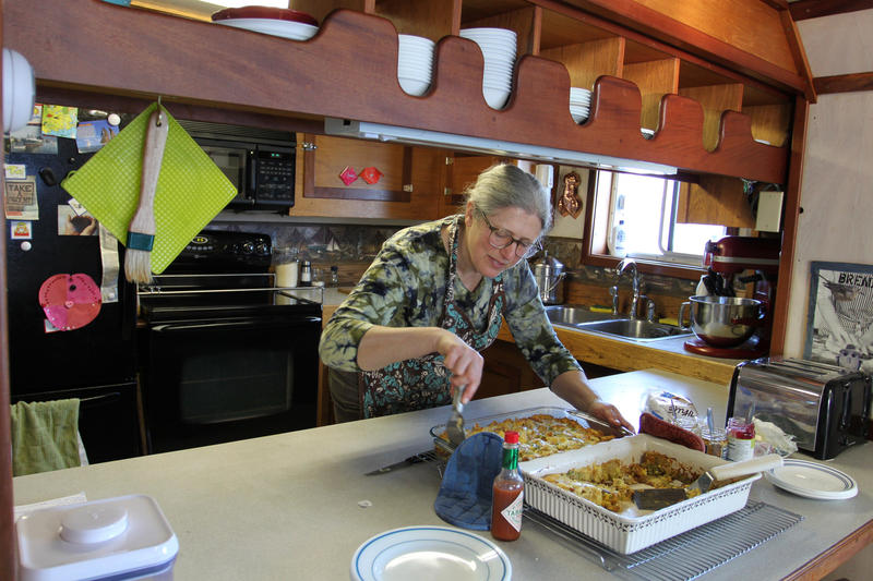 Boat Steward Barbara Myer serves up some breakfast casserole.