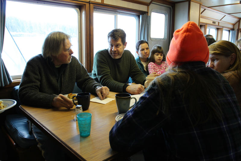 Islanders chat with Douglas Cornman, second from the left, interim mission worker aboard the Sunbeam.