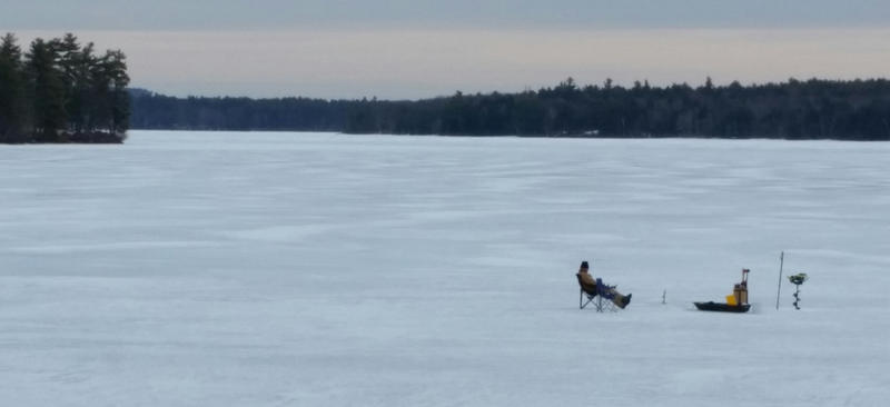 Zach Wozich ice fishing recently on Thompson Lake, near his home in Casco.