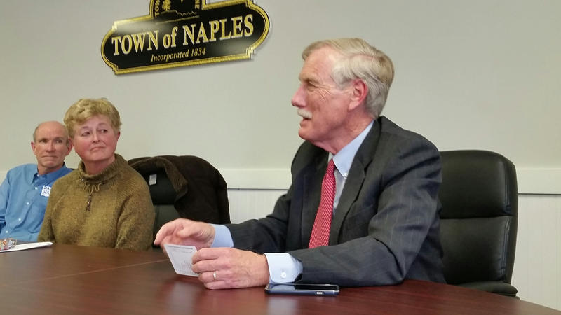 "Sen. Angus King explains his ""climate change in a nutshell"" graph to an audience recently in Naples."