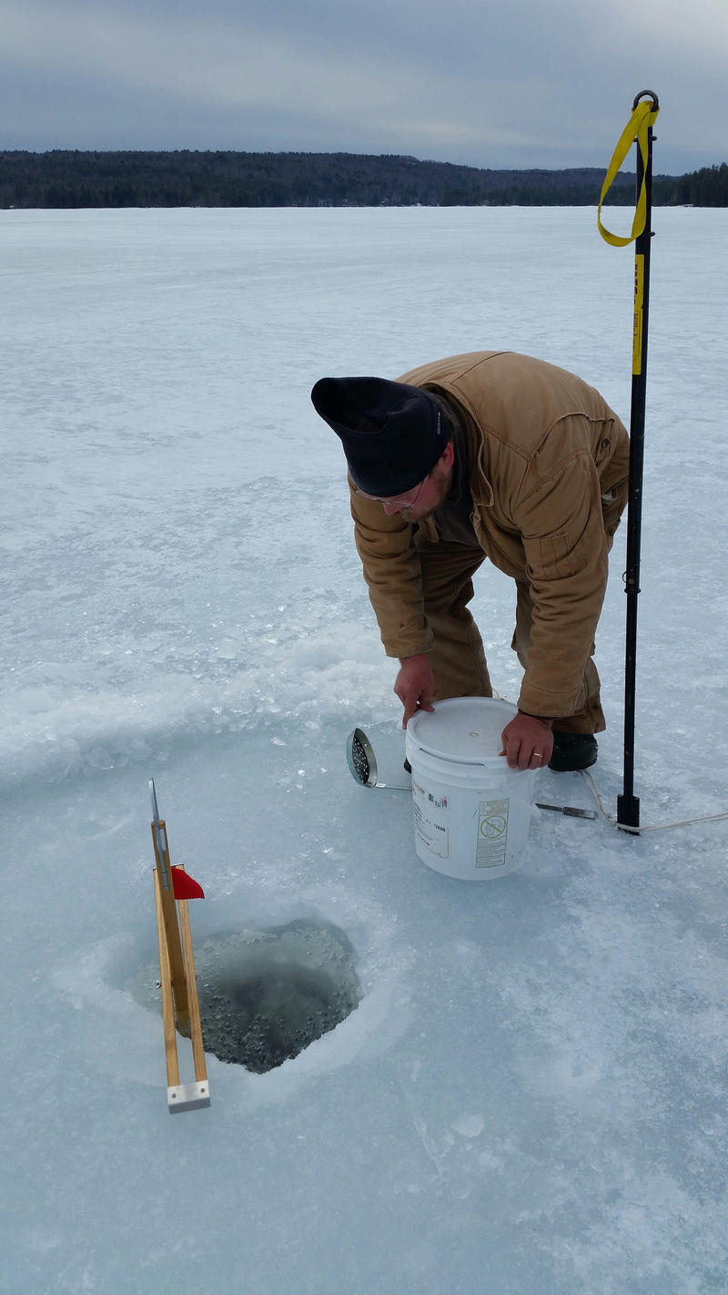 Zach Wozich sets his ice-fishing lines recently on Thompson Lake near Casco.