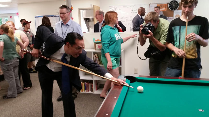 HUD Secretary Julian Castro shoots pool Friday at the New Beginnings homeless shelter for teens in Lewiston.