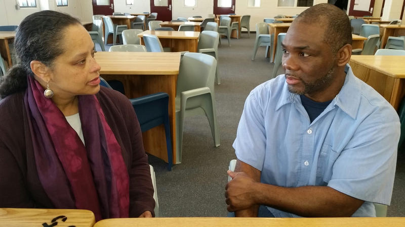 Rachel Talbot Ross of the Portland Chapter of the NAACP (left) speaks with Maine State Prison inmate Foster Bates, a member of the NAACP's prison chapter.