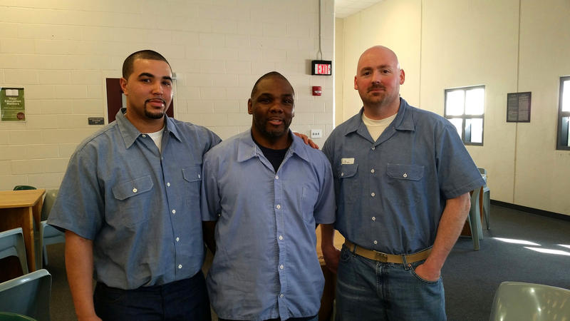 Foster Bates, center, of the Maine State Prison NAACP chapter, with fellow members Sergio Hairston, left, and Shaun Libby.