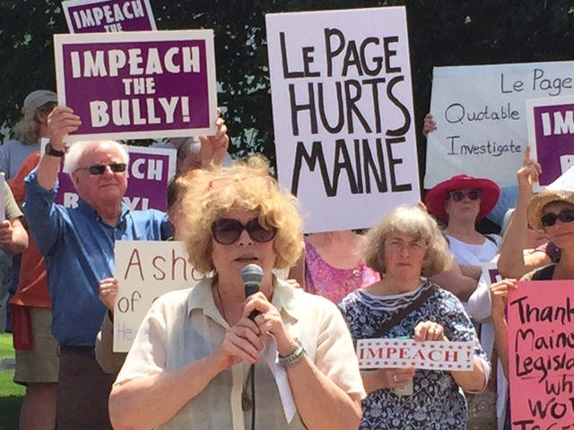 Cushing Samp, of Saco, leads about 200 demonstrators Tuesday at the State House who are demanding an investigation into Gov. Paul LePage's activities.