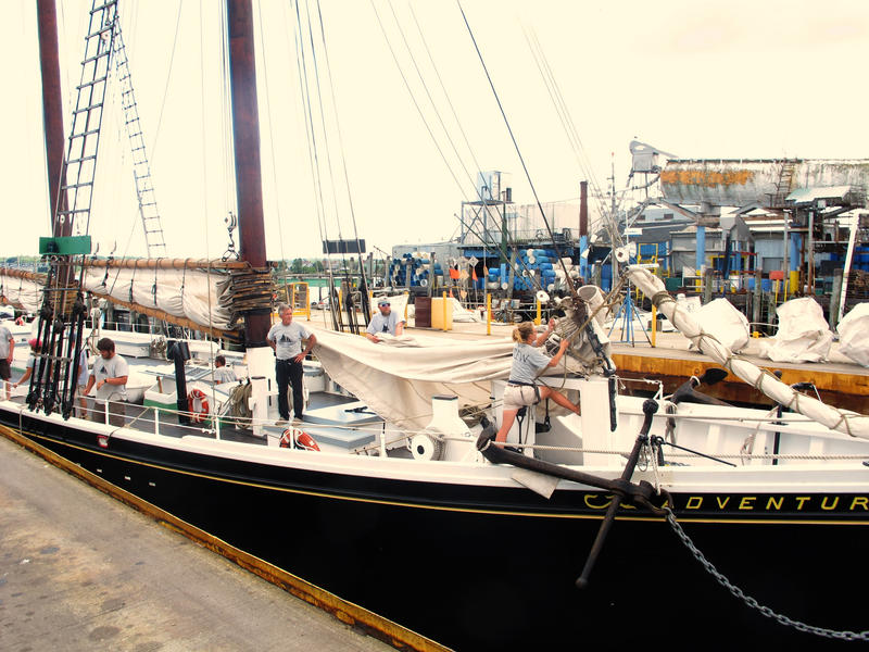 Crew members prepare for the Adventure to set sail for Boston with tons of Maine-grown farm produce.