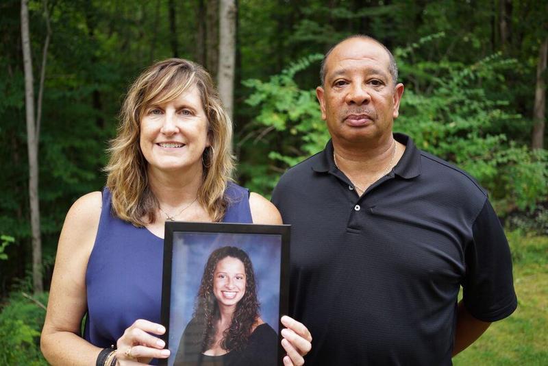 Judi and Wayne Richardson, holding a photo of their daughter Darien.
