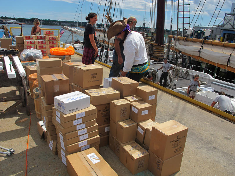 Boxes of Maine-produced products are packed onto the ship as it gets ready to sail.