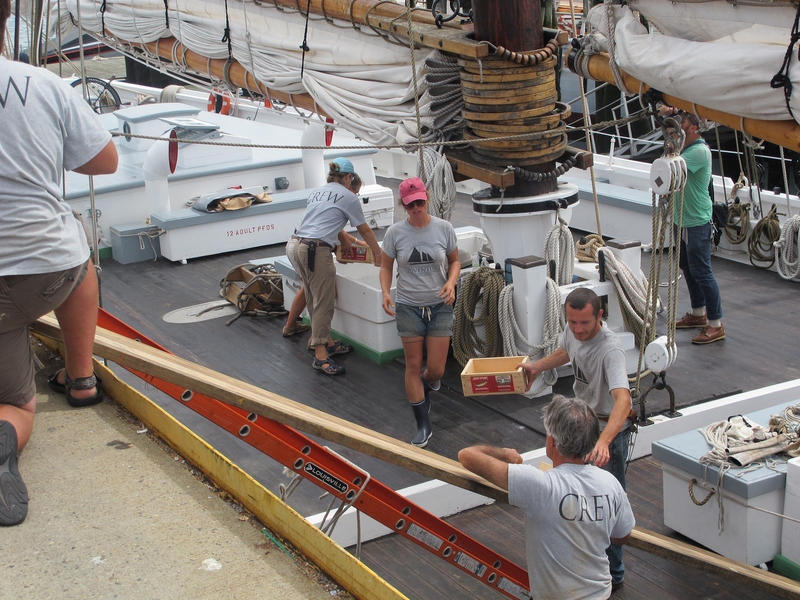 The Adventure teems with workers getting the ship ready to sail.