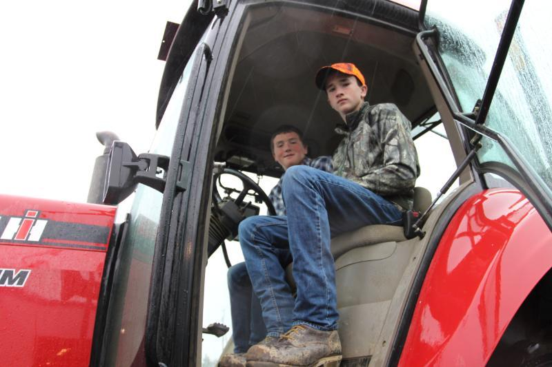 Carson (left) and Kyle Flewelling work 12-hour days on their family farm in Easton during harvest break, spading up about 700 acres of russets for the fry and chip markets.