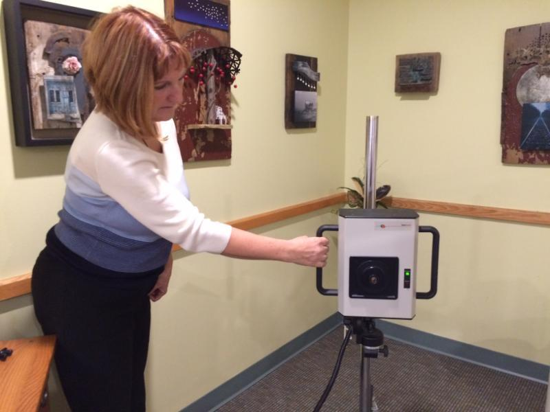 Ingrid LeVasseur shows a thermography machine.