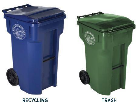 A recycling bin next to a trash bin in Biddeford, Maine.