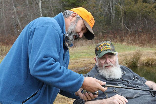 Maine Master Guide Bob Howe gives Rip Thibodeau a refresher course in fishing for trout.
