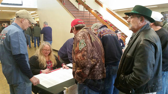 Shipyard workers check in to vote Sunday.