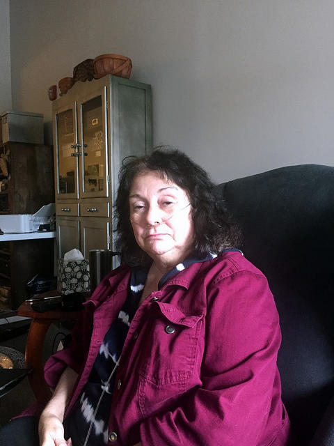 Robyn Rosser, in her apartment in Lewiston