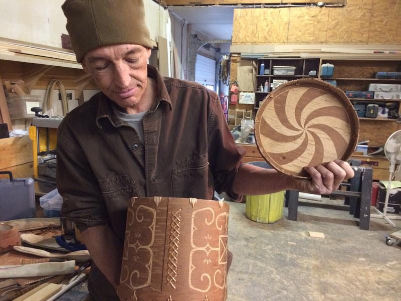 David Moses Bridges with one of his birchbark baskets.