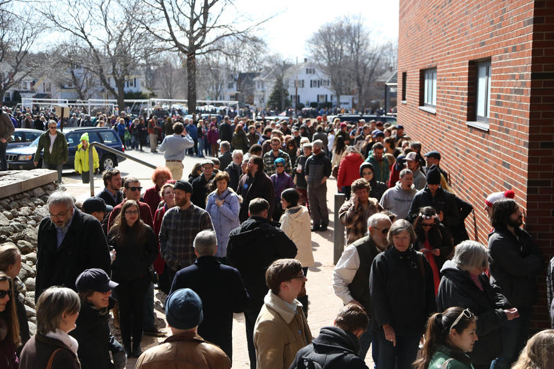 Thousands of Democrats crowd outside Deering High School Sunday waiting to caucus.