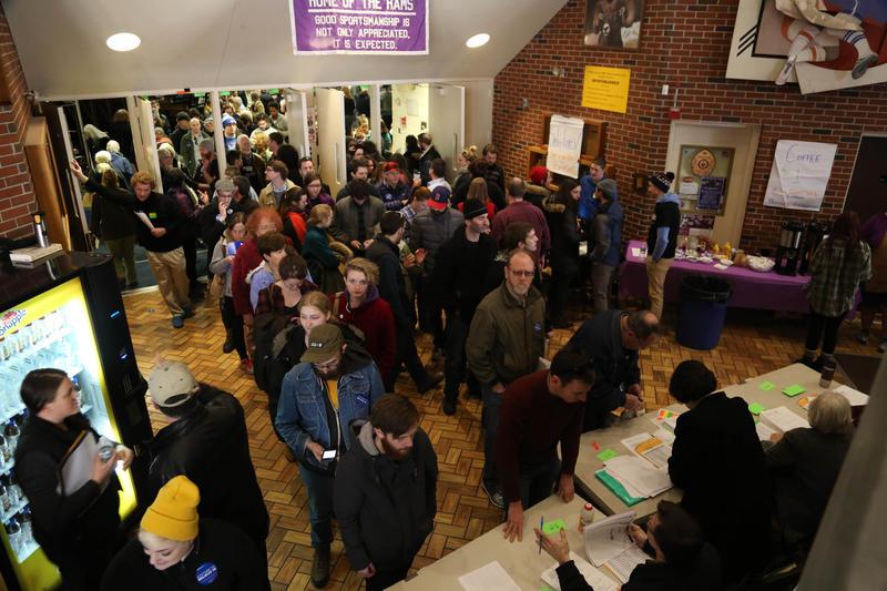 Democratic voters crowd into Deering High School Sunday to caucus.