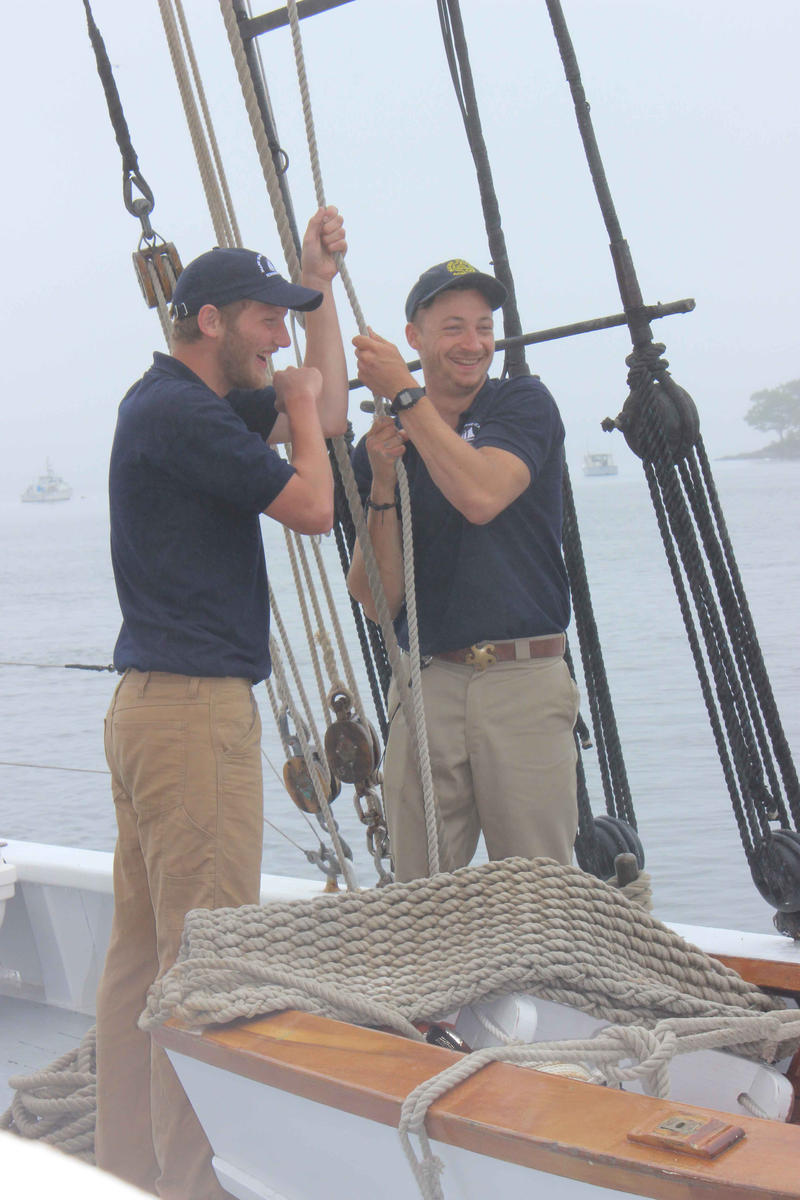 Crew members on the Schooner Bowdoin raise the sails in Castine on June 16, 2015