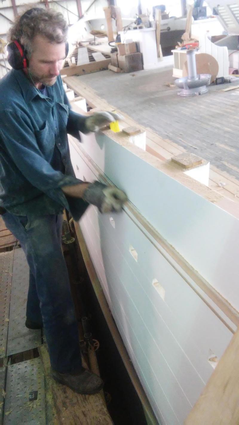 Lyman-Morse employee Brian McClellan doing woodwork on the Bowdoin