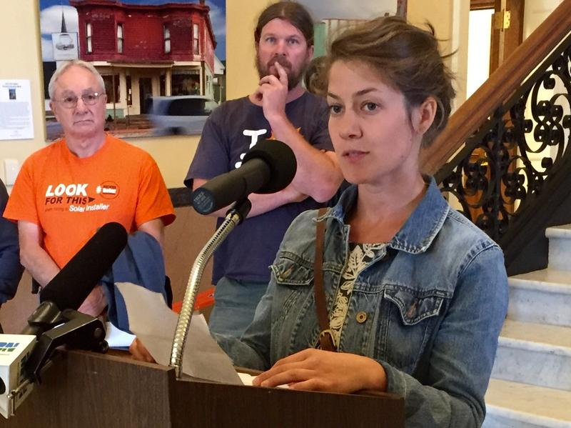 Caitlin Frame, co-owner of The Milkhouse in Monmouth at an Augusta news conference to urge lawmakers to maintain net metering policy.