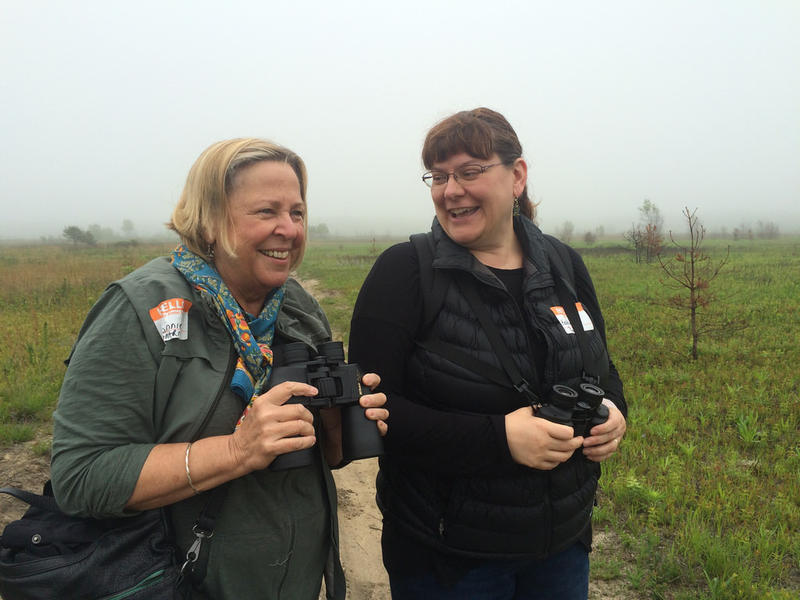 """Connie Hubley (left), of Winthrop, Maine and Kathleen Harger(right), of Readfield in a conversation during the Birds on Tap tour at the Kennebunk Plains. They call themselves """"nerdy birders."""""""