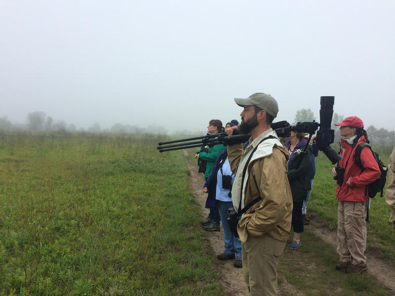 Derek Lovitch, birding expert and tour guide with a group from the Birds on Tap tours at the Kennebunk Plains.