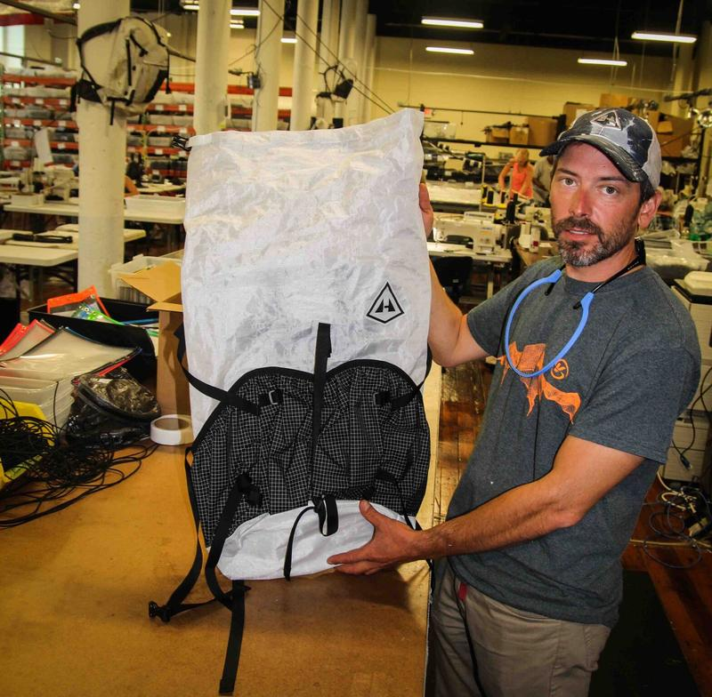Hyperlite Mountain Gear CEO Mike St. Pierre holding a pack made at the factory in Biddeford.