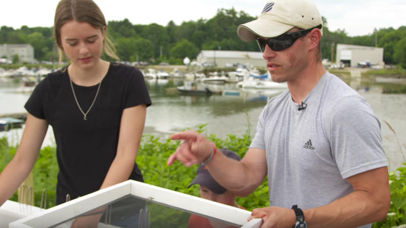 Yarmouth 7th-grade teacher Morgan Cuthbert (right) instructs students in a clam project, made possible through private funding.