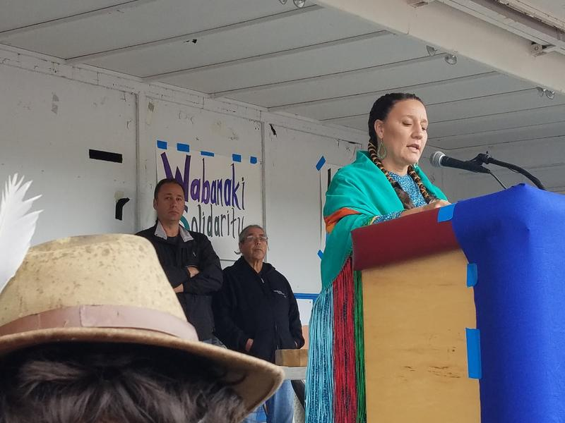 Sherri Mitchell, a member of the Penobscot Nation, flanked by Penobscot leaders, addresses the gathering to call for solidarity and promotion of clean water and tribal sovereignty.