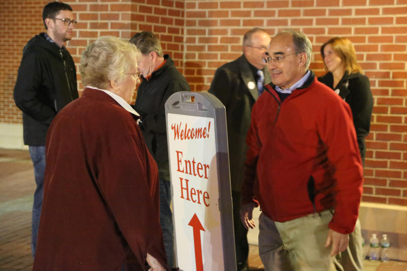 Rep. Bruce Poliquin greets voters at the Cross Insurance Center in Bangor.